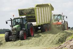 silage with two tractors - stock photo