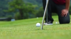 Golf player strikes ball on golf course Stock Footage