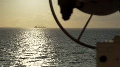 Cargo ship sailing in the sea at sunset Stock Footage