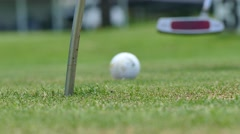 Golf player taking his putt on green golf course  Stock Footage