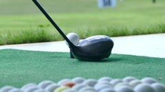 Driving golf-ball on the green - stock footage