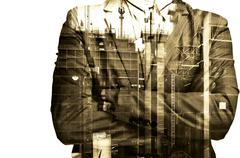 Double exposure Businessman or Civil Engineer stand with Construction site Stock Photos