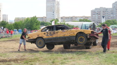 Destruction crash derby show - loader takes out broken participant car from ring Stock Footage