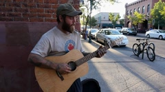A street musician performs for people passing by - Flagstaff, Arizona Stock Footage