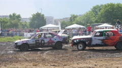 Destruction crash derby show - cars participants ride field ring bamping Stock Footage