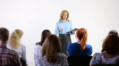 Beautiful business woman is speaking on conference. Stock Footage