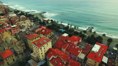 Colorful houses along the beach and waves. Aerial drone video.N Stock Footage