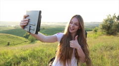 Sunshine Beautiful caucasian woman making selfie on tablet - stock footage