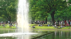 Tokyo - Pople gathering in Yoyogi park on a sunday afternoon by the lake. 4K Stock Footage
