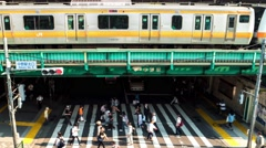 Tokyo - Nakano station time lapse of people, trains and traffic. 4K panning Stock Footage