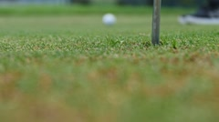 Golf player strikes ball on golf course - stock footage