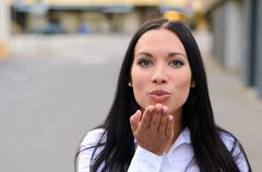 Gorgeous seductive woman blowing a kiss Stock Photos