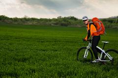 Young man is riding bicycle outside. Healthy Lifestyle. - stock photo