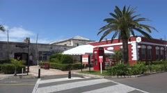 Cooperage building (modern Crafts Market) with the Red telephone box. Bermuda Stock Footage