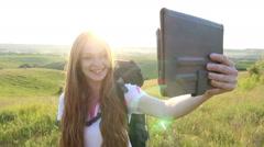 Sunshine Beautiful caucasian woman making selfie on tablet - stock footage