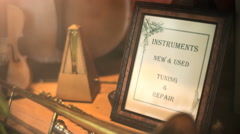 Instruments. New and Used, Tuning and Repair. - stock footage