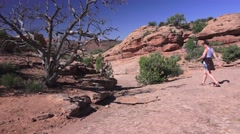 ARCHES NATIONAL PARK, Woman hiker wearing shorts and sandals, Stock Footage