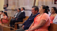 A couple listening to the mass in a church during a wedding celebration. Stock Footage