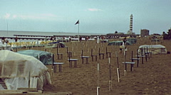 Jesolo, Italy 1978: people walking on the beach Stock Footage