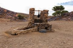 water well in Sahara desert - stock photo