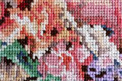 Closeup of cross stitch - stock photo