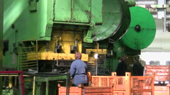 Woman puts component under press machine AutoVAZ factory Stock Footage