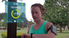 Running Checking Fitness Stats on Smart Watch with Graphics Stock Footage