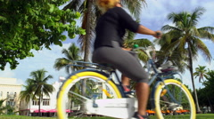 Miami Florida tourists bicycle on South Beach 5K Stock Video Footage Stock Footage