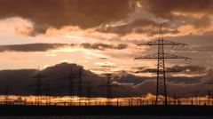 Electrical towers with a red sky and clouds Stock Footage
