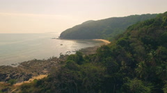 Pristine tropical forest and sea in Thailand. Slight camera movement, aerial N. - stock footage