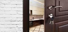 Half open door of a modern kitchen closeup Stock Photos