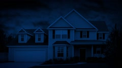 House In Suburbs On Windy Night Stock Footage