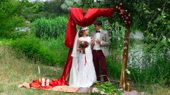 Bride and groom drink shampagne in the forest Stock Footage