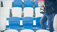 A guy in VR glasses and popcorn sitting on the tribune - stock footage