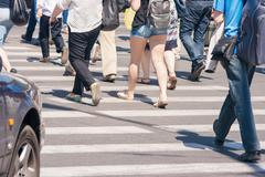 pedestrians in a crosswalk - stock photo