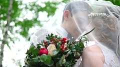 the bride and groom covered with a veil - stock footage