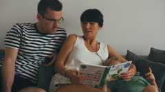 Young Family Bonding at Home - Caucasian Parents With Son on Sofa - stock footage
