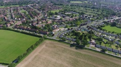 Aerial of UK suburban area with nearby countryside Stock Footage