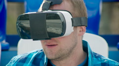 Happy guy in VR glasses Stock Footage