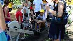 Family holiday day of a family day, Ukraine. Boy and sports exercise machine. Stock Footage