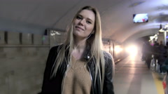 Сute girl with long blonde hair in leather jacket with straightens hair - stock footage