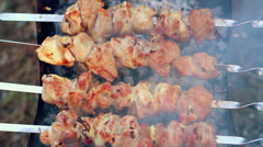BBQ meat cooking on charcoal. Closeup. Woman tasting piece of meat Stock Footage