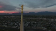 Rotating aerial view of Angel Moroni close up with sunset Stock Footage