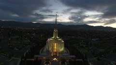 Front aerial view of LDS Temple in Oquirrh Mountain fly over Stock Footage