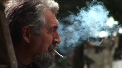 Senior man smoking Stock Footage