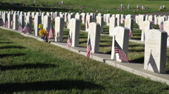 Angled Dolly across military headstones Stock Footage