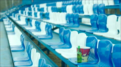 Empty tribune with a bottle and popcorn bucket only Stock Footage