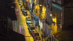 Cuenca, Ecuador. Traffic on rainy streets at night. 4K time lapse - stock footage