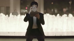 young successful asian man using tablet computer. city night lights scene - stock footage