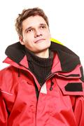 Young man in waterproof clothing. - stock photo